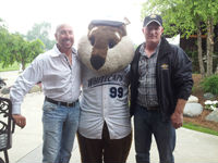 Auctioneers Scott Vander Kolk Jr. and Lucas Spoor with the West Michigan Whitecaps mascot crash at a recent Mel Trotter fundraiser golf outing
