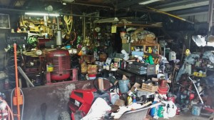 Small cluttered garage photo at Skurka Estate auction Sparta Michigan 2014