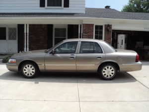 This 2005 Mercury Grand Marquis sold at onlie only auction in Farmington Hills, Michigan 2014 brought $6050.00