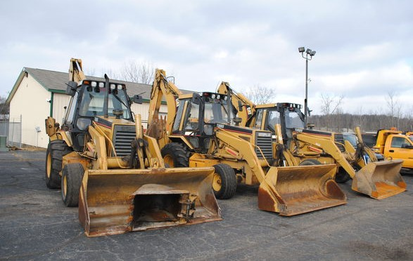 Municipal backhoes sold at a 2015 M & W auction.