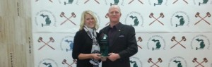 Scott and Abby Vander Kolk with the 2013 'Auctioneer of the Year' trophy