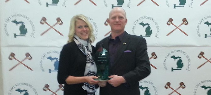 Scott and Abby Vander Kolk with the 2013 'Auction of the Year' trophy