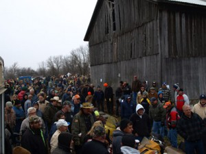 Scene from Potter estate sales auction with people buying snowmobiles