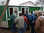 auction buyer registration Bidders waiting to register for an auction in Grandville Michigan